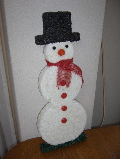 Sneeuwpop hoogte 198, dikte 5 cm.